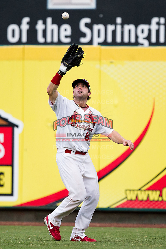 Chris Swauger (8) of the Springfield Cardinals fields a ball hit to right field during a game against the Northwest Arkansas Naturals at Hammons Field on July 31, 2011 in Springfield, Missouri. Northwest Arkansas defeated Springfield 9-1. (David Welker / Four Seam Images)