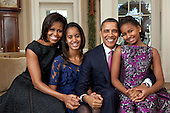 United States President Barack Obama, First Lady Michelle Obama, and their daughters, Sasha and Malia, sit for a family portrait in the Oval Office, December 11, 2011. .Mandatory Credit: Pete Souza - White House via CNP