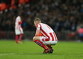 9th December 2017, Wembley Stadium, London England; EPL Premier League football, Tottenham Hotspur versus Stoke City; Ryan Shawcross, the Stoke City captain crouching in disappointment after Christian Eriksen of Tottenham Hotspur scored his sides 5th goal in the 74th minute to make it 5-0
