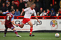 Byron Harrison of Stevenage races past Mark McChrystal of Tranmere . - Stevenage v Tranmere Rovers - npower League 1 - Lamex Stadium, Stevenage - 17th December 2011  .© Kevin Coleman 2011 ... ....  ...  . .