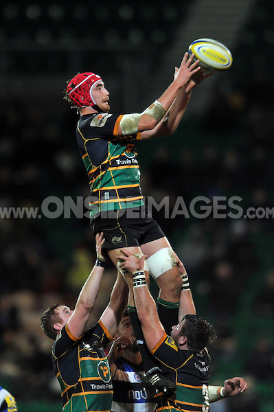 Alex Woolford rises high to win lineout ball. Aviva A-League final, between Northampton Wanderers and Bath United on December 16, 2013 at Franklin's Gardens in Northampton, England. Photo by: Patrick Khachfe / Onside Images