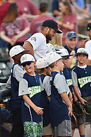 Designated hitter Tim Tebow (15) of the Columbia Fireflies poses for a photo with youth baseball players before a game against the Lexington Legends on Saturday, April 22, 2017, at Spirit Communications Park in Columbia, South Carolina. Lexington won, 4-0. (Tom Priddy/Four Seam Images)