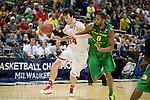 Wisconsin Badgers center Frank Kaminsky (44) drives to the basket during the third-round game in the NCAA college basketball tournament against the Oregon Ducks Saturday, April 22, 2014 in Milwaukee. The Badgers won 85-77. (Photo by David Stluka)