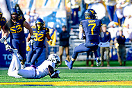 Morgantown, WV - NOV 10, 2018: West Virginia Mountaineers quarterback Will Grier (7) spins out of a would be tackle during second half action of game between West Virginia and TCU at Mountaineer Field at Milan Puskar Stadium Morgantown, West Virginia. (Photo by Phil Peters/Media Images International)