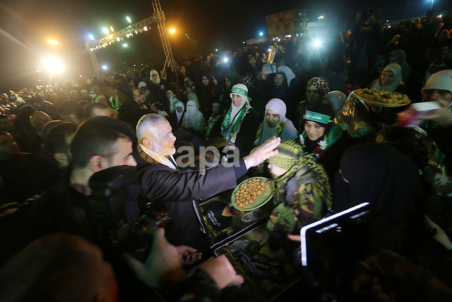 Senior Hamas leader Ismail Haniyeh attends a gathering to pay tribute to the brigade's militants who died after a tunnel collapsed in the Gaza Strip on January 31, 2016 in Gaza city. Seven Hamas militants were killed on January 28, 2016 after a tunnel built for fighting Israel collapsed in the Gaza Strip, highlighting concerns that yet another conflict could eventually erupt in the Palestinian enclave. Photo by Mohammed Asad