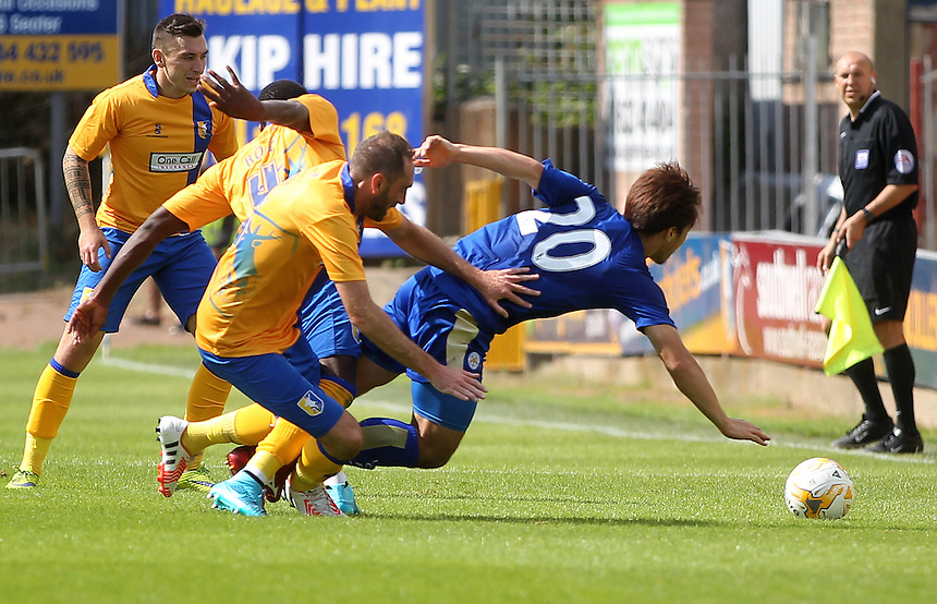Leicester City's Shinji Okazaki in action with Mansfield Town's Ryan Tafazolli<br />