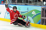 Adam Dixon (11) celebrates his first period goal during 2010 Paralympic Games sledge hockey action at UBC Thunderbird Arena in Vancouver. Credit: CPC/HC/Matthew Manor.