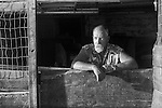 A portrait of a farmer in a Chicken Stall