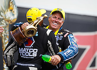 Sep 18, 2016; Concord, NC, USA; NHRA funny car driver John Force (right) celebrates with Antron Brown after winning the Carolina Nationals at zMax Dragway. Mandatory Credit: Mark J. Rebilas-USA TODAY Sports