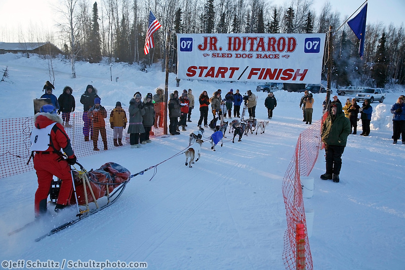 Sunday, February 25th, Willow, Alaska.  Jr. Iditarod musher Jessica Klejka crosses the finish line in 3rd   place