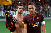 Calcio, Serie A: Roma vs Milan. Roma, stadio Olimpico, 25 aprile 2014.<br /> AS Roma midfielder Miralem Pjanic, of Bosnia, celebrates with teammate Francesco Totti, right, after scoring during the Italian Serie A football match between AS Roma and AC Milan at Rome's Olympic stadium, 25 April 2014.<br /> UPDATE IMAGES PRESS/Riccardo De Luca
