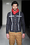 Model walks runway in an outfit from the Antinoo Menswear Fall Winter 2017 collection by Lily Montes, for the Prêt-À- Porter Fall Winter 2017 runway show on February 12, 2017; during FGNYFW Fall Winter 2017.