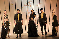 Models pose in designer clothes in opening show of China Fashion Week at the Beijing Hotel, China