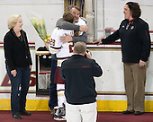 Betsy Leary, Peter Leary, Kate Leary (BC - 28), Courtney Kennedy (BC - Associate Head Coach) -  The Boston College Eagles defeated the visiting Boston University Terriers 5-0 on BC's senior night on Thursday, February 19, 2015, at Kelley Rink in Conte Forum in Chestnut Hill, Massachusetts.