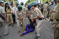 Pictured: Police arrest a congress activist <br /> Re: Activists of the Congress political party clash with police in protest against price rises in oil, gas and other daily commmodities by BJP government in Agartala, in the Tripura area of India. Monday 10 September 2018