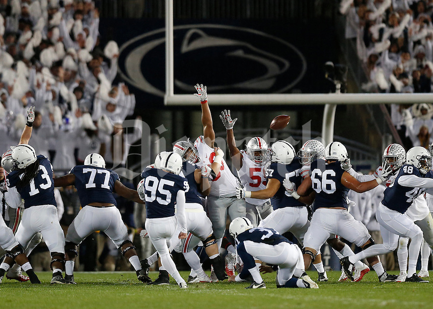 Ohio State Buckeyes defensive lineman Dre'Mont Jones (86) blocks a field goal attempt by Penn State Nittany Lions place kicker Tyler Davis (95) during the first quarter of the NCAA football game at Beaver Stadium in State College, Penn. on Oct. 22, 2016. (Adam Cairns / The Columbus Dispatch)