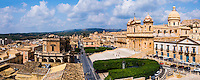 Panoramic photo of Noto Cathedral (St Nicholas Cathedral, Cattedrale di Noto) and Noto Town Hall (Municipio), Noto, Val di Noto, UNESCO World Heritage Site, Sicily, Italy, Europe. This is a panoramic photo of Noto Cathedral (St Nicholas Cathedral, Cattedrale di Noto) and Noto Town Hall (Municipio), Noto, Val di Noto, UNESCO World Heritage Site, Sicily, Italy, Europe.