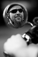 Larz Adams revs the engine of his new Harley Davidson in Holden, Massachusetts.