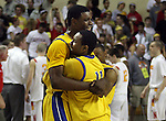 Jefferson's Terrence Jones and Tyrone Phillips leaps celebrate their 66-49 win over North Eugene in the semifinals of the 5A boys state championship at McArthur Court Friday March 13, 2009.