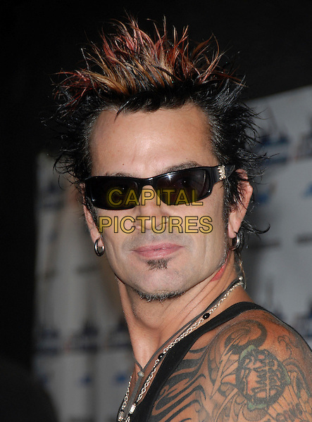 TOMMY LEE.The Rockstar Supernova kick off party held at The Roxy in West Hollywood, California, USA. .July 13th, 2006.Ref: DVS.headshot portrait sunglasses shades tattoos.www.capitalpictures.com.sales@capitalpictures.com.Supplied By Capital PIctures