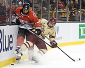 Drew Ellement (Northeastern - 2), Johnny Gaudreau (BC - 13) - The Boston College Eagles defeated the Northeastern University Huskies 7-1 in the opening round of the 2012 Beanpot on Monday, February 6, 2012, at TD Garden in Boston, Massachusetts.