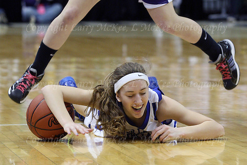 Lexis Robak, Waterford Our Lady of the Lakes, takes being knocked to the floor by an Athens defender with a smile, during Class D state championship action at the Breslin Center Saturday, March 17, 2012.