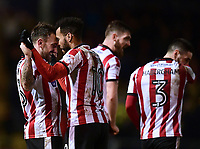 Lincoln City's Neal Eardley, left, celebrates scoring the opening goal with team-mate Matt Green<br /> <br /> Photographer Chris Vaughan/CameraSport<br /> <br /> The EFL Sky Bet League Two - Lincoln City v Cheltenham Town - Tuesday 13th February 2018 - Sincil Bank - Lincoln<br /> <br /> World Copyright &copy; 2018 CameraSport. All rights reserved. 43 Linden Ave. Countesthorpe. Leicester. England. LE8 5PG - Tel: +44 (0) 116 277 4147 - admin@camerasport.com - www.camerasport.com