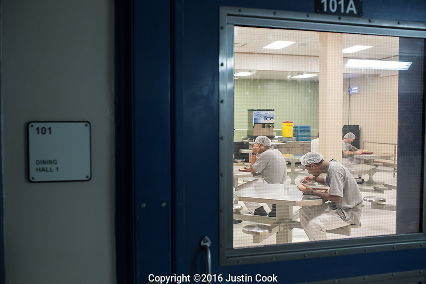 Inmates eat at a cafeteria in Central Prison in Raleigh, NC on Thursday, November 17, 2016. (Justin Cook)