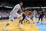 16 November 2014: North Carolina's Justin Jackson (left) beats Robert Morris's Rodney Pryor (center) and Lionel Gomis (1) to a loose ball. The University of North Carolina Tar Heels played the Robert Morris University Colonials in an NCAA Division I Men's basketball game at the Dean E. Smith Center in Chapel Hill, North Carolina. UNC won the game 103-59.