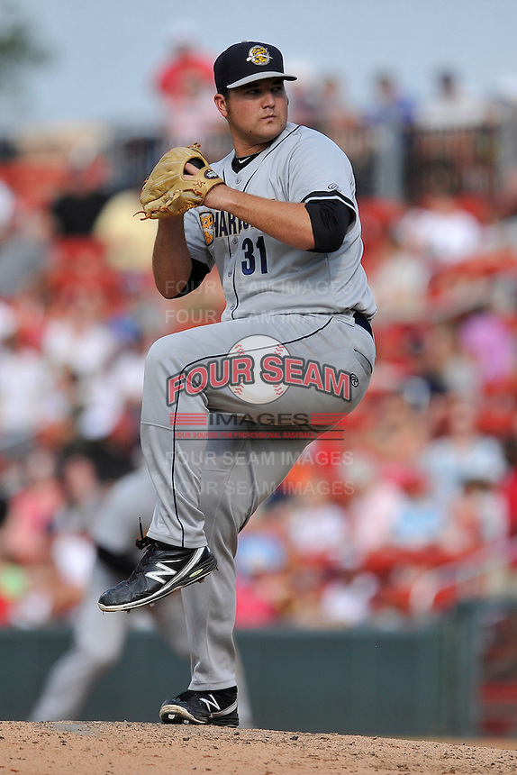 Pitcher Sean Carley (38) of the Charleston RiverDogs delivers a pitch in a game against the Greenville Drive on Sunday, August 16, 2015, at Fluor Field at the West End in Greenville, South Carolina. Charleston won, 6-2. (Tom Priddy/Four Seam Images)
