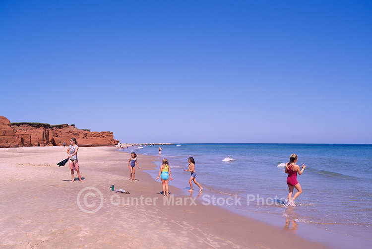 Ile du Havre-aux-Maisons, Iles de la Madeleine, Quebec, Canada - Children playing on Beach at Dune du Sud along Gulf of St. Lawrence - (South Dune, House Harbour Island, Magdalen Islands)