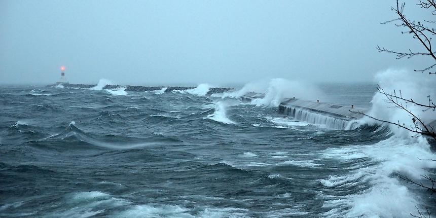 A December winter storm moving over Lake Superior. Presque Isle Breakwater, Marquette, MI