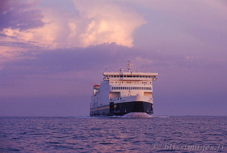 Seawind Line approaches through a purple dawn in the Archipelago Sea of southern Finland.