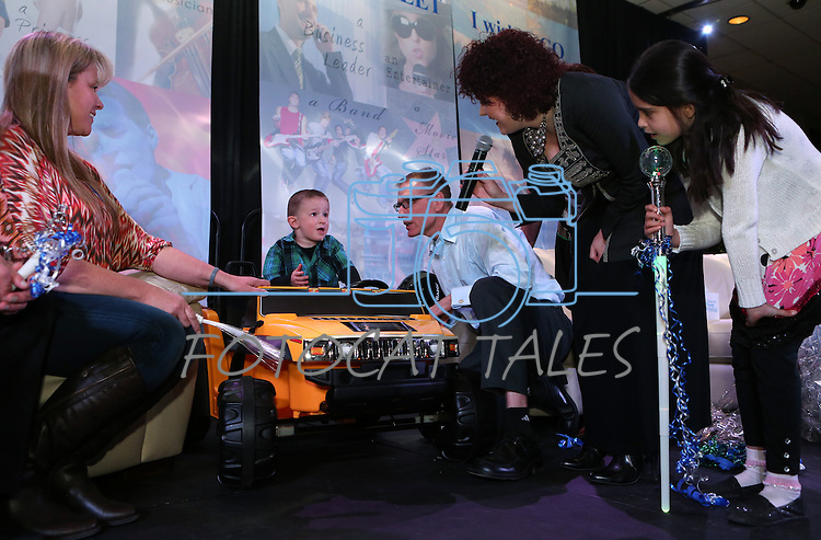 Nevada First Lady Kathleen Sandoval and her daughter Marisa, right, talk with Isaac Young, 3, after he received his new Hummer at the Make-A-Wish Waffles & Wishes event at the Atlantis Casino Resort Spa in Reno, Nev., on Tuesday, March 26, 2013. Isaac, who is fighting liver cancer, also received his wish of a trip to the San Francisco Bay area through the sponsorship of UnitedHealthcare. .Photo by Cathleen Allison/Nevada Photo Source
