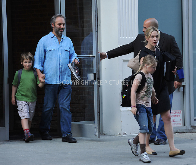 WWW.ACEPIXS.COM . . . . . ....April 8 2010, New York City....Director Sam Mendes and his wife actress Kate Winslet take their children Mia Honey and Joe Alfie to school on April 8 2010 in New York City....Please byline: KRISTIN CALLAHAN - ACEPIXS.COM.. . . . . . ..Ace Pictures, Inc:  ..tel: (212) 243 8787 or (646) 769 0430..e-mail: info@acepixs.com..web: http://www.acepixs.com