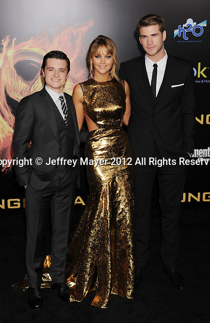 LOS ANGELES, CA - MARCH 12: Josh Hutcherson, Jennifer Lawrence and Liam Hemsworth attend 'The Hunger Games' World Premiere at Nokia Theatre at LA Live on March 12, 2012 in Los Angeles, California.
