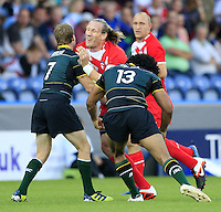 PICTURE BY CHRIS MANGNALL /SWPIX.COM...Rugby League - International Origin Match  - England v Exiles - Galpharm Stadium, Huddersfield, England  - 04/07/12... England's  Eorl Crabtree tackled by Exiles scott Dureau and Sia Soliola