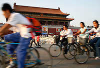 Afternoon commuters ride their bicycles near the Tiananmen Square in Beijing, China..06 Sep 2006