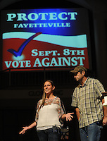 NWA Democrat-Gazette/ANDY SHUPE<br /> Melissa and Aaron Klein of Gresham, Oregon, speak Tuesday, Aug. 11, 2015, during a rally in opposition of the city of Fayetteville's proposed Uniform Civil Rights Protection ordinance at University Baptist Church in Fayetteville. The Kleins own a bakery and refused to bake a wedding cake for a lesbian couple in conflict with Oregon law. Protect Fayetteville organized the rally as a &ldquo;rally against religious persecution&quot; ahead of the Sept. 8 vote to approve the ordinance.
