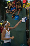 March 26 2016: Timea Bacsinszky (SUI), signs autographs for fans after winning at the Miami Open being played at Crandon Park Tennis Center in Miami, Key Biscayne, Florida.