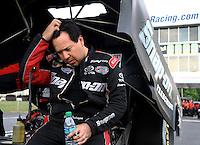 May 15, 2015; Commerce, GA, USA; NHRA funny car driver Cruz Pedregon reacts during qualifying for the Southern Nationals at Atlanta Dragway. Mandatory Credit: Mark J. Rebilas-USA TODAY Sports