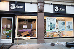 © Joel Goodman - 07973 332324 . 09/08/2011 . Manchester , UK . A looted 3 store in St Ann's Square , as disorder spreads to Manchester during a 4th night of rioting and looting , following a protest against the police shooting of Mark Duggan in Tottenham . Photo credit : Joel Goodman