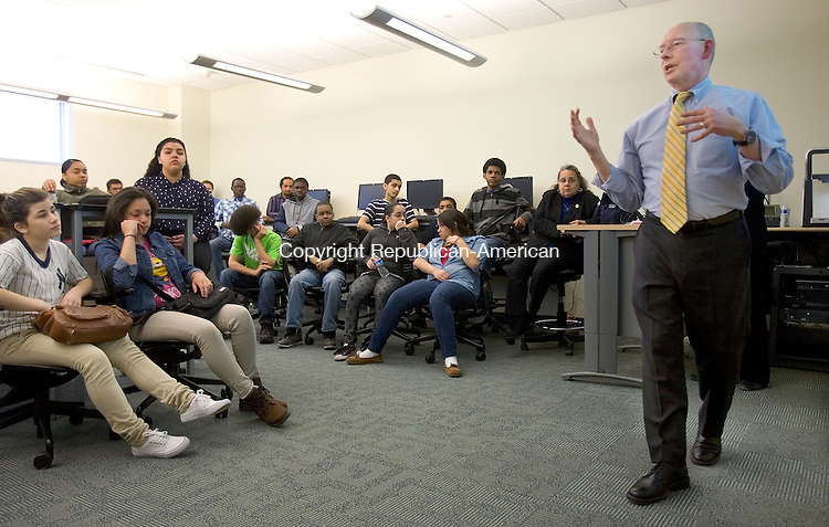WATERBURY CT. 05 April 2014-040514SV01-At right, Chuck Lasky, Naugatuck Valley Community College professor, teaches a cell phone applications class to high school students at the college in Waterbury Saturday. <br /> Steven Valenti Republican-American