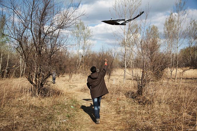 Serbia, Subotica, 01.04.2012: After a long and cold winter Sajad from Pakistan (name changed) is playing with a kite on one of the first days of spring. <br /> <br /> Serbien, Subotica, 01.04.2012: An einem der ersten Fr&uuml;hlingstage nach einem langen und kalten Winter l&auml;&szlig;t Sajad aus Pakistan (Name ge&auml;ndert) einen Drachen steigen.<br /> <br /> [ CREDIT: www.throughmyeyes.de - Merlin Nadj-Torma - Boeckhstr. 26 - 101 - 10967 Berlin - phone +49-177-8279119 - merlin@throughmyeyes.de ]