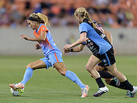 Rachel Daly (3) of the Houston Dash races for the Chicago goal in the second half with Alyssa Mautz and Danielle Colaprico (24) of the Chicago Red Stars in pursuit on Saturday, April 16, 2016 at BBVA Compass Stadium in Houston Texas.