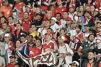 BOGOTÁ-COLOMBIA-16-02-2016: Hinchas de Santa Fe corean a su equipo durante partido entre Independiente Santa Fe de Colombia y Cerro Porteño de Paraguay de la fecha 1 por la segunda fase, llave G8, de la Copa Bridgestone Libertadores 2016 jugado en el estadio Nemesio Camacho El Campin de la ciudad de Bogotá./ Fans of Santa Fe cheer for their team during a match between Independiente Santa Fe of Colombia and Cerro Porteño of Paraguay of the date 1 for the second phase, G8 key, of the Copa Bridgestone Libertadores 2016 played at Nemesio Camacho El Campin stadium in Bogota city.  Photo: VizzorImage/ Gabriel Aponte /Staff