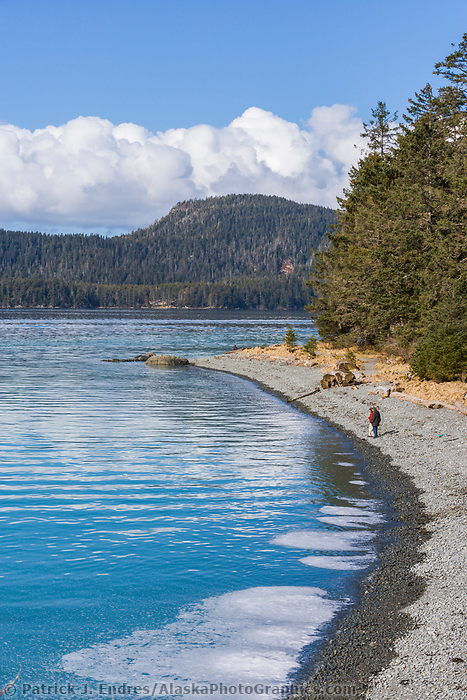 People enjoy a stroll along the beach at Halibut point, Sitka Sound, southeast, Alaska