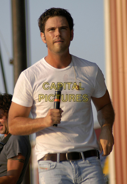 CHUCK WICKS. Jamboree In The Hills 2008, the Superbowl of Country Music, is a four day Country Music Festival established in 1977 with over 100,000 people in attendance this year, Morristown, Ohio, USA, 17 July 2008..half length live on stage gig jeans white t-shirt funny .CAP/ADM/KB.© Kelly Blecher/Admedia/Capital Pictures