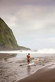 USA, Hawaii, The Big Island, paddle boarder Abraham Shouse in the lush Waipio Valley