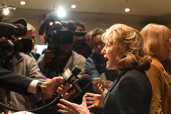 """April 16, 2014. Durham, North Carolina.<br />  Senator Kay Hagan, right, spoke with the press after an event to award a posthumous Bronze Star. Hagan has been largely absent from the campaign trail even as several Republican challengers have mounted campaigns to defeat her in this year's election.<br />  Kay Hagan (D),  US Senator from North Carolina, attended an event to honor the military service of Donald """"Buddy"""" Moore, Hagan awarded Moore's widow Wanda a posthumous Bronze Star, as well as several other medals, for his service in World War II."""